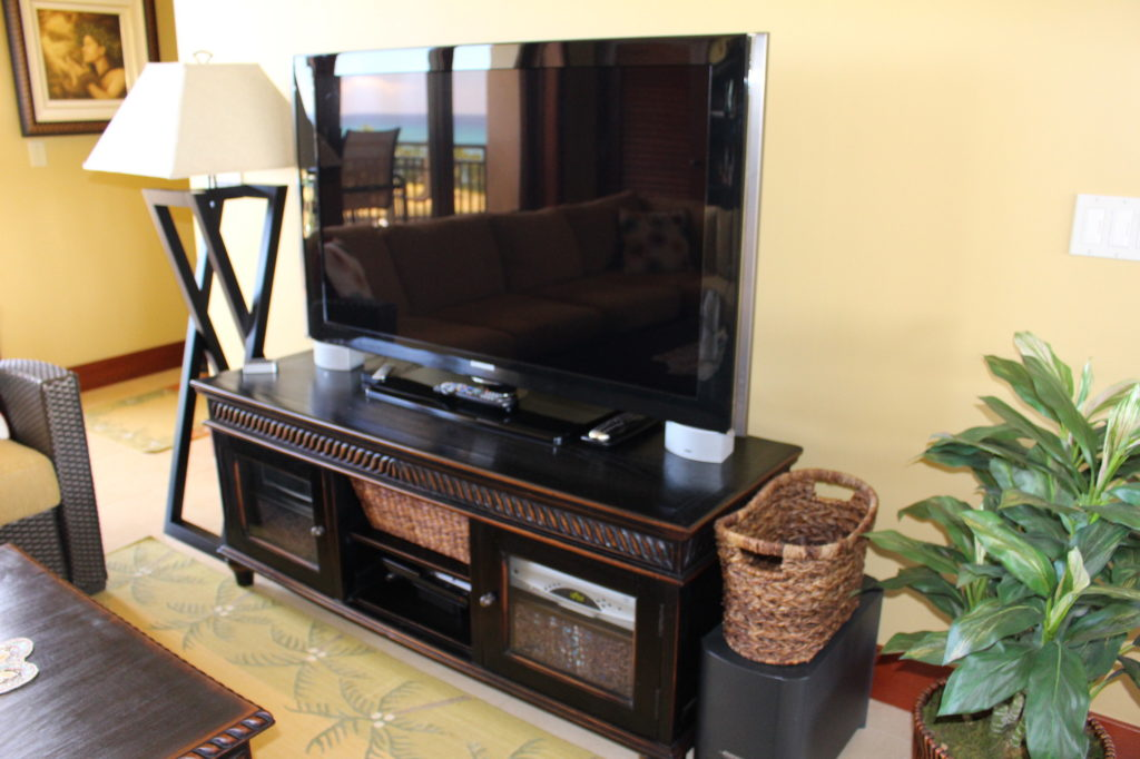 Samsung TV on top of Baik Designs - Black Rubbed TV Console