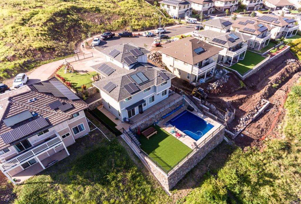 Aerial view of lot, pool, yard, PV solar