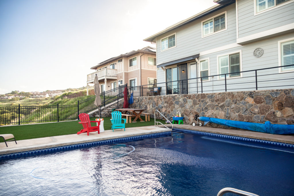 Highly upgraded exterior elements with in-ground salt-water pool, high-grade artificial turf, retain